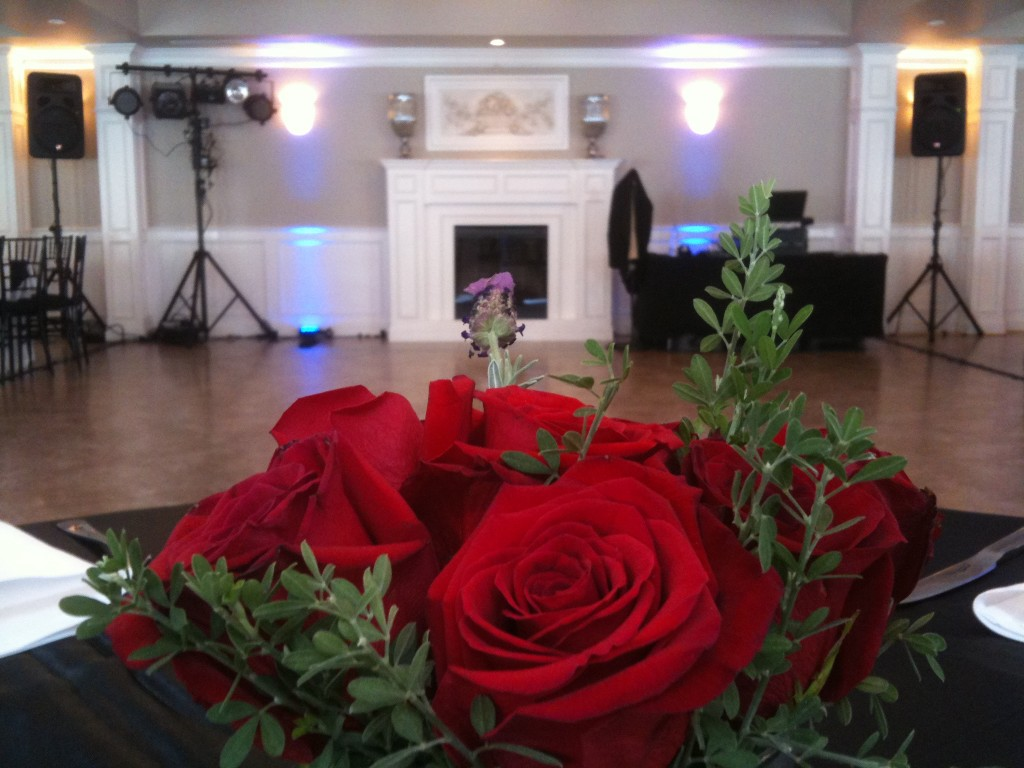 Beautiful bouquet center piece; DJ setup in background