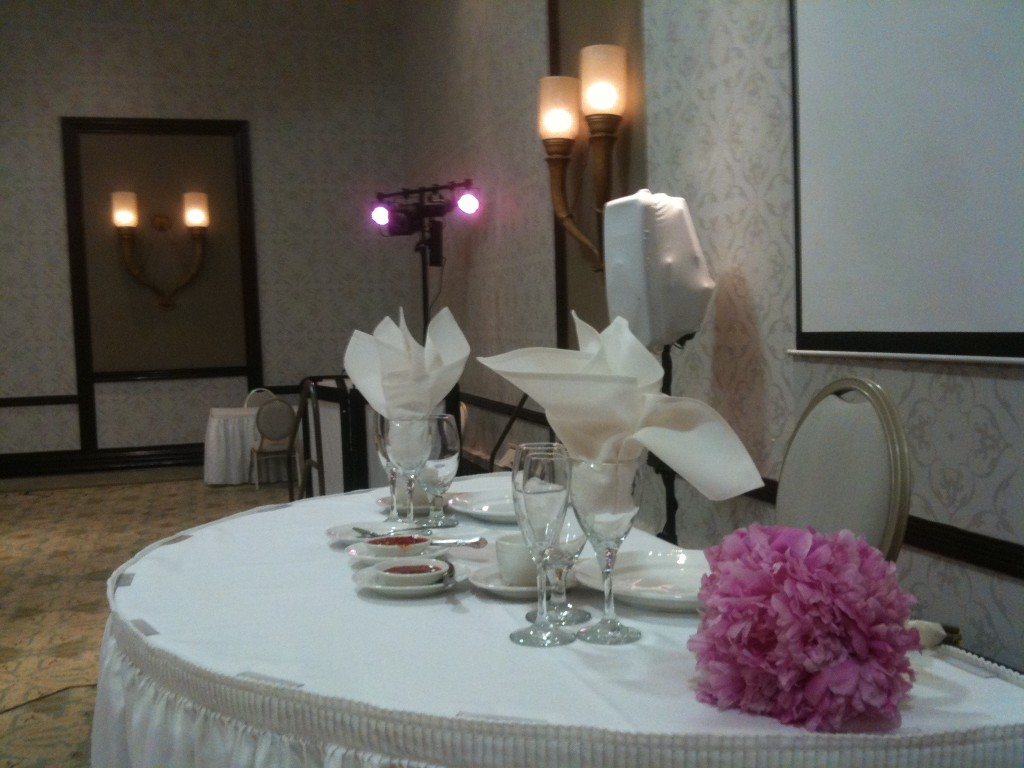 Sweetheart table with DJ booth in background
